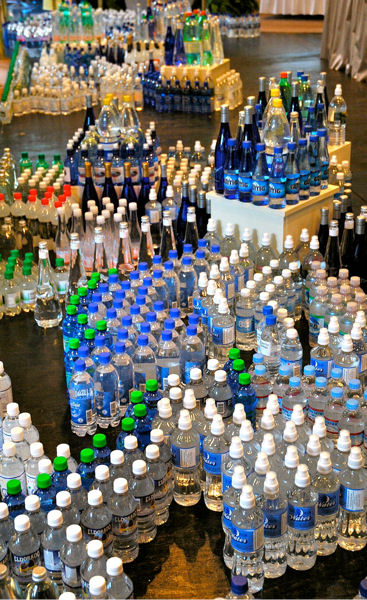 Bottled water entries are displayed at the water tasting event. Photo courtesy of Travel Berkeley Springs.