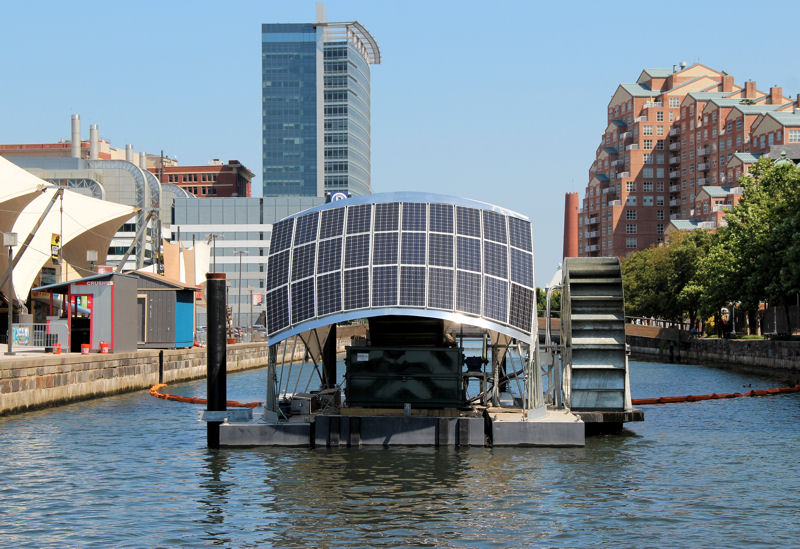 Either the river's current or water pumped by solar panels moves a conveyor belt that lifts trash out of the water. Photo courtesy of the Waterfront Partnership of Baltimore.