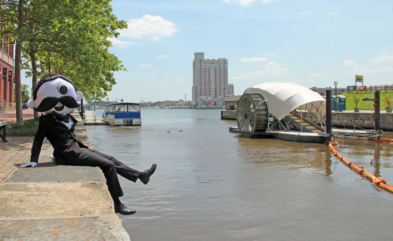 Mr. Boh, the one-eyed mascot of National Bohemian, a beer first brewed by National Brewing Co. (San Antonio, Texas) in 1885 in Baltimore, celebrates Mr. Trash Wheel. Photo courtesy of the Waterfront Partnership of Baltimore.