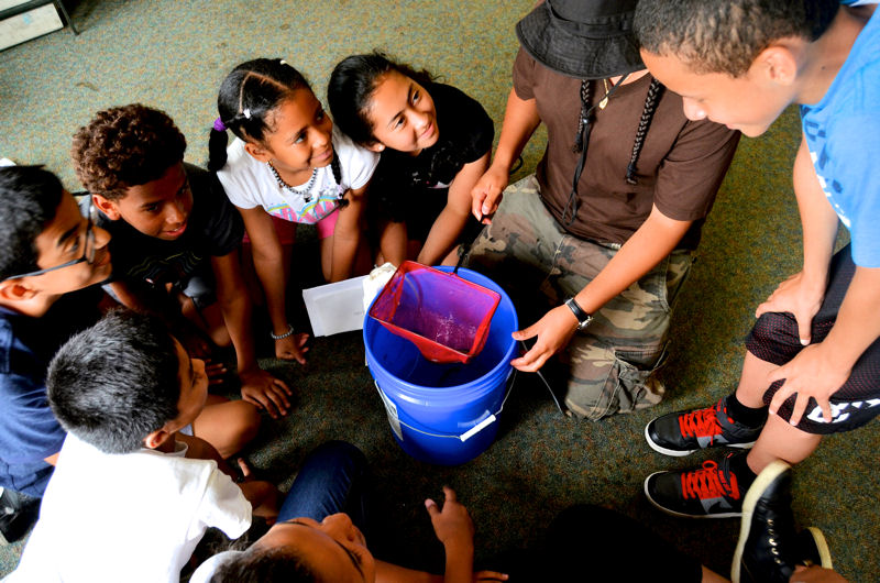The On-Water Classroom activities such as monitoring aqatic species helps youths build self-confidence, maintain healthy relationships, and acquire skills to finish high school. Photo courtesy of Rocking the Boat.