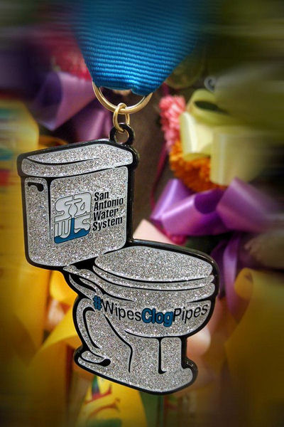 The San Antonio Water System has awarded toilet medals to spread awareness about wipes clogging pipes. Photo courtesy of San Antonio Water System.