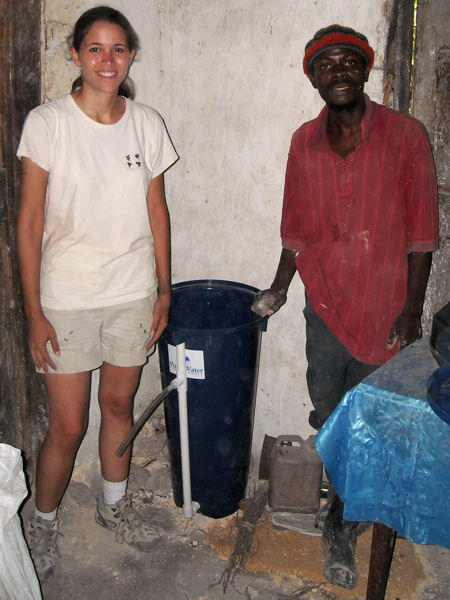 Dykstra stands with a resident of Mare Brignol, Haiti, following the installation of the first household slow sand filter for water purification, as part of an Engineers Without Borders project. Photo courtesy of James Crawford.