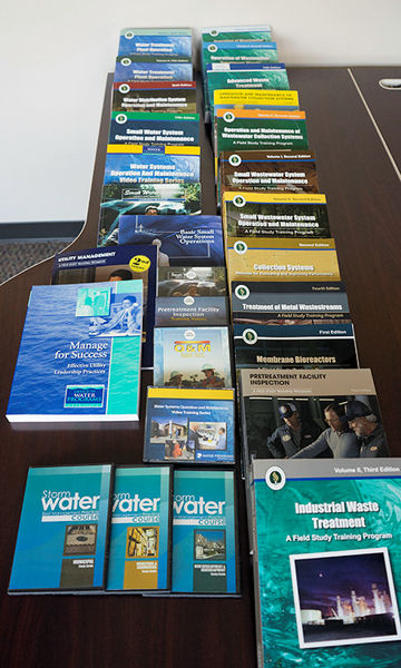 The program uses these manuals to educate students on a variety of stormwater, water treatment, and wastewater topics. Photo courtesy of the Office of Water Programs at California State University, Sacramento.
