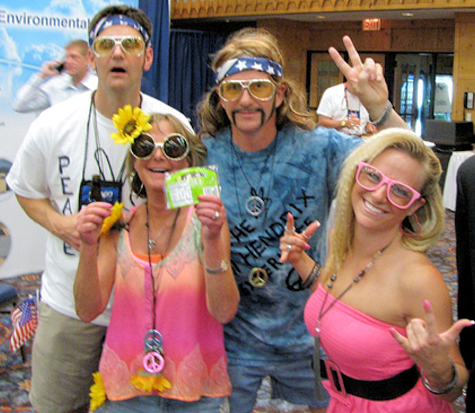 A recent Michigan Water Environment Association annual conference featured a 1960s themed icebreaker, and Hamlett Environmental Technologies leadership — from left, Scott Kafka, Sue Hamlett, Randy Hamlett, Jennifer Zelski — joined in the fun. Photo courtesy of the Hamlett family.