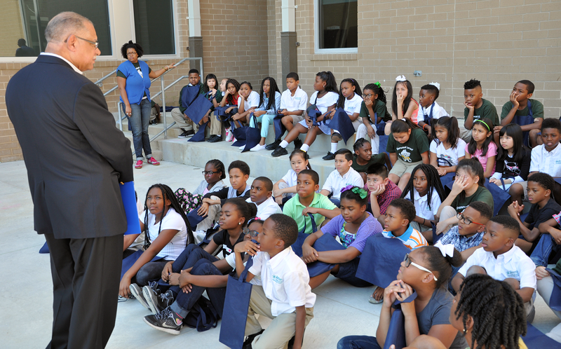 Cedric Grant, executive director of the Sewerage and Water Board of New Orleans, speaks with fourth graders about the importance of water at the fourth annual Water Palooza education day. Photo courtesy of Einstein Charter Schools (New Orleans).
