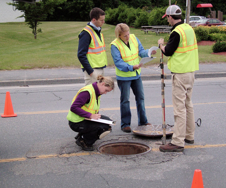 Perkins works with coworkers to improve wastewater and stormwater collection systems in Fitchburg, Mass. Photo courtesy of Perkins,Wright-Pierce.