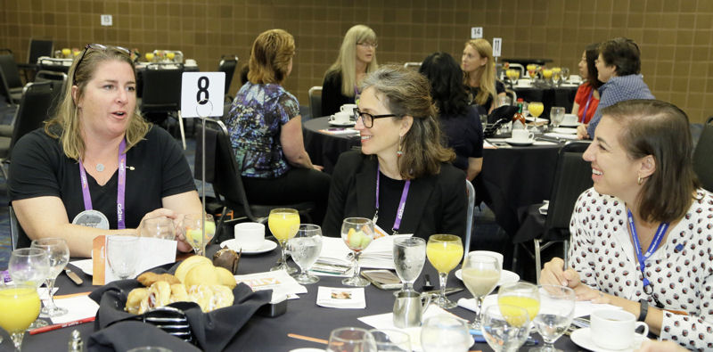 Malfronte (right) talks to other water professionals at her table during the Women in Water Breakfast. Photo courtesy of Oscar & Associates.