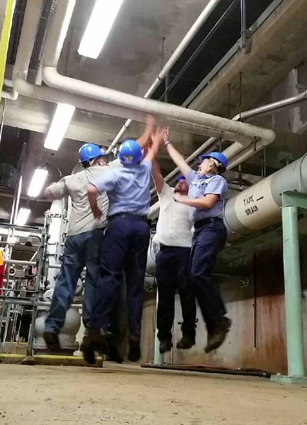 NEORSD staff, from left, Mike Canfield, Ryan Kelly, Chad Leasure, and Christen Wood, celebrate a job well done at their facility. Photo courtesy of Leasure.