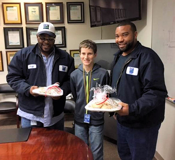 Cameron Weeks (center) shares cookies with Clifford Woods (left) and Andrew Moore (right) as a way to thank the operators at the Denton Creek Regional Wastewater System (DCRWS; Roanoke, Texas) for their hard work providing a vital resource for the local community. Photo courtesy of Mary Weeks.