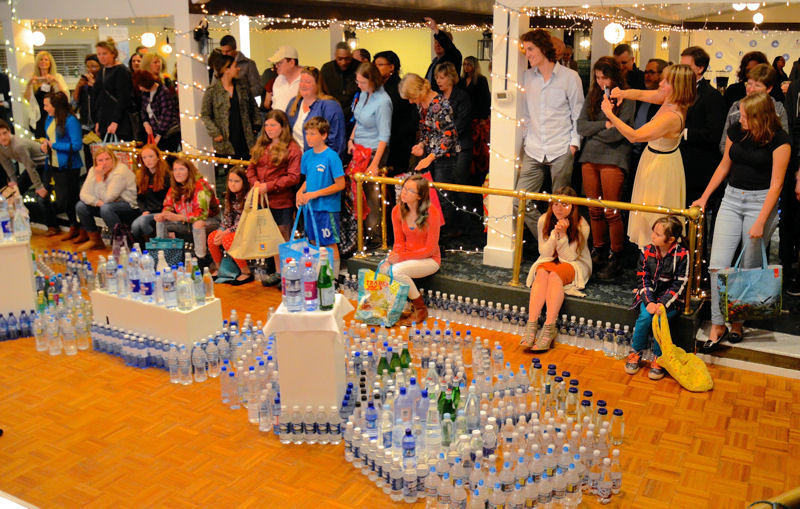 Spectators eagerly await the water rush for their chance to take bottled water home. Photo courtesy of Travel Berkeley Springs.