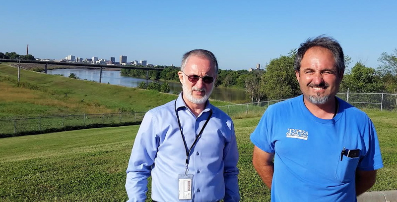 From left, Sylvan and his son, Dustin Coles, who both work for the City of Topeka's wastewater department, take a picture together at the Okland Wastewater Treatment Plant. Photo courtesy of the Coles family.