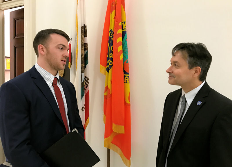 From right, Christopher Stacklin, member of the California Water Environment Association, talks to Alexander Lee, legislative aide for U.S. Rep. Mimi Walters (R–Calif.), during the 2017 National Water Policy Fly-In & Expo. Photo courtesy of Ed McCormick.