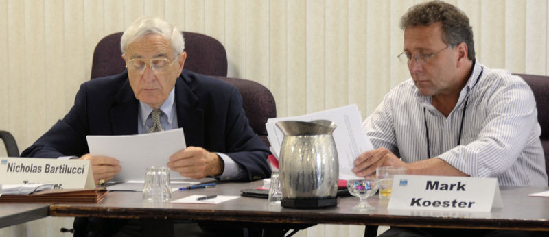 Bartilucci (left) delivers a budget report at a NYWEA board meeting while sitting next to Koester. Photo courtesy of Skibinski.