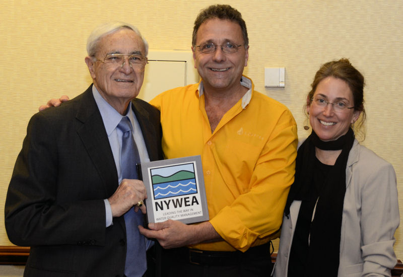 From left, Bartilucci stands with Mark Koester, NYWEA president in 2012 and Patricia Cerro-Reehil, NYWEA executive director during a ceremony to honor his retirement during a NYWEA board meeting. Photo courtesy of Skibinski.