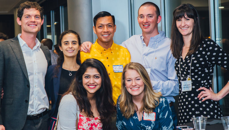 A group of young professionals take a break from networking at the 2017 Young Professionals to get a photo together. Photo courtesy of Ashley Waldron photography.