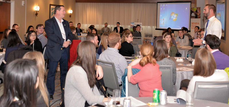 WEF speaker of the House of Delegates, Howard Carter (standing left), welcomes YPs to the summit. Photo courtesy of Amanda Lade, NEWEA.