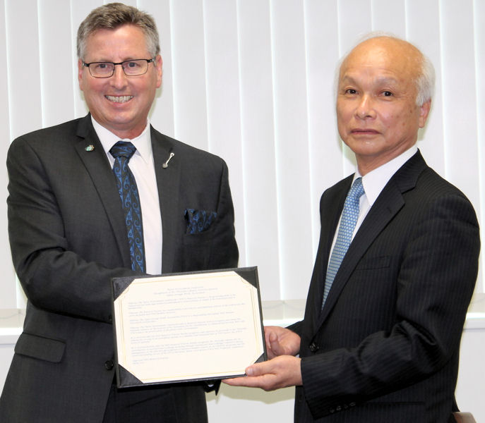 From left, Rick Warner, WEF President 2016–2017, presents Hisataka Sokawa, influential Japanese water sector leader, with a certificate recognizing Sokawa's influence on the global water environment. Photo courtesy of the Japan Sewage Works Association.