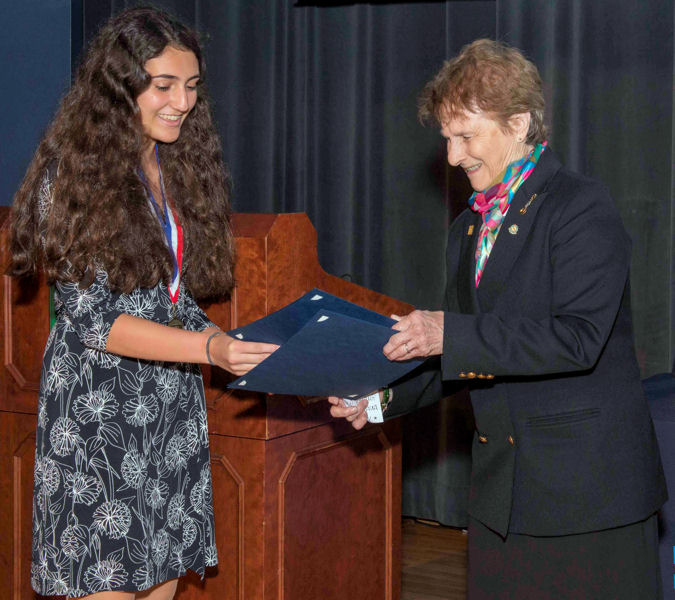 Ana Humphrey of Alexandria, Va., receives her runner-up certificate from Jeanette Brown, head judge of the 2017 U.S. SJWP competition. Humphrey developed a mobile app to identify and count E. coli. Photo courtesy of AOB Photo.
