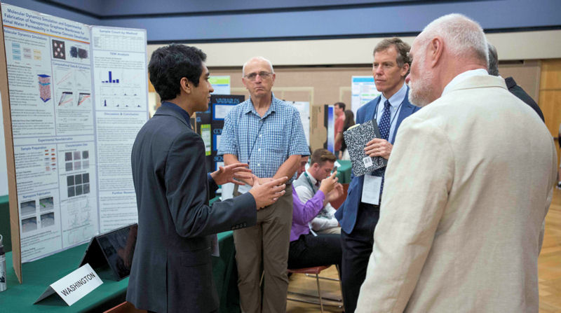 Apoorv Khandelhal of Sammamish, Wash., a runner-up in the SJWP competition, talks to judges about his research into optimal permeability of membranes for desalination. Photo courtesy of AOB Photo.