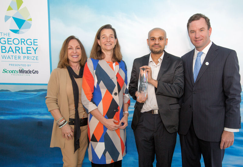 At a ceremony held March 22 by the Everglades Foundation (Palmetto Bay, Fla.), Prashanth Kumar of overall Stage 1 winning team WETSUS NaFRAd (third from left) accepts $25,000 in prize money alongside (from left) Mary Barley, wife of late conservationist George Barley; Nathalie Olijslager-Jaarsma, consul-general of the Netherlands; and Everglades Foundation CEO Eric Eikenberg. Photo courtesy of Jenny Abreu Photography.