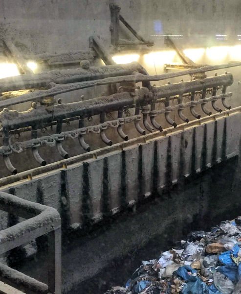 During a tour of AEB Amsterdam, Jen McDonnell saw the incinerator's cake sludge delivery system that continuously drops solids onto a conveyor that feeds the burner. Photo courtesy of McDonnell.