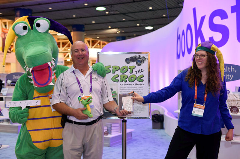 A Spot the Croc winner poses with Niles the Crocodile at WEFTEC 2016. Photo courtesy of Oscar & Associates.