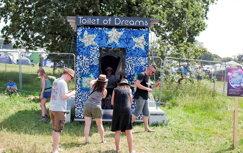 In addition to taking photos in the Toilet of Dreams, Festival-goers learned about WaterAid's #TheWaterFight to provide clean water and decent toilets around the world by 2030. Photo courtesy of WaterAid, Emily Graham.