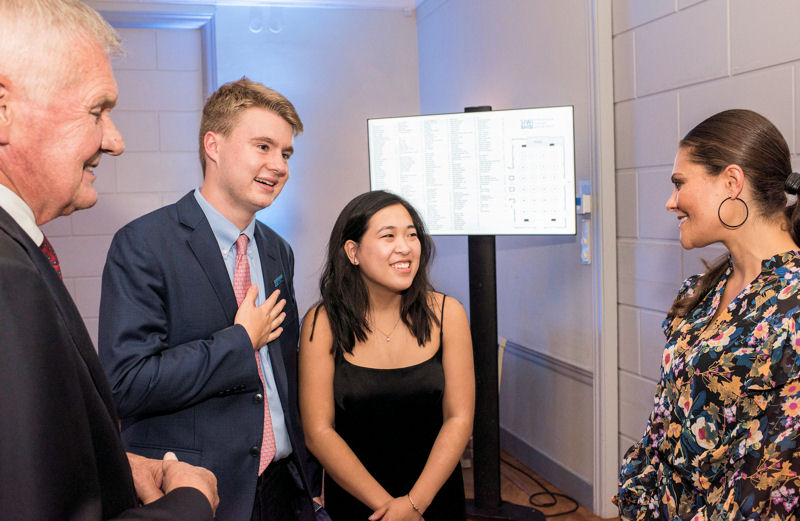 SIWI chairman Peter Forssman (left) and Crown Princess Victoria of Sweden (right) talk to Thorpe and Chang who won the 2017 SJWP for their development of a biosensor to detect and filter to remove E.coli from water. Photo courtesy of Borg, SIWI.