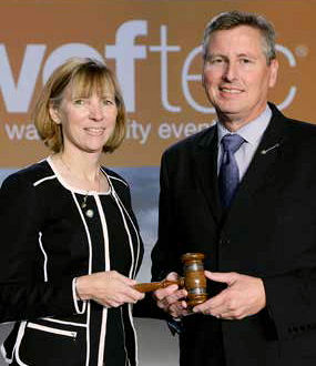 "From left, Jenny Hartfelder, the 2017–2018 Water Environment Federation (WEF; Alexandria, Va.) president, receives the ""gavel of leadership"" from Rick Warner, WEF immediate past president, during WEFTEC 2017. Photo courtesy of Oscar & Associates."