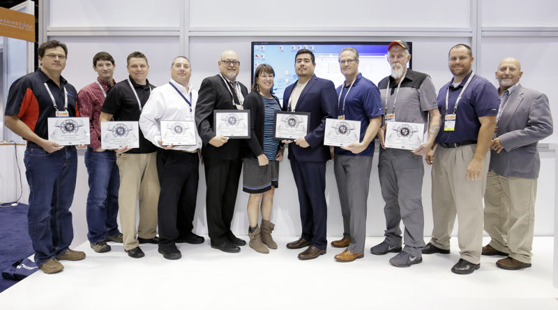 Hawley (center) stands with winners of the 2017 Operator Ingenuity Contest at WEFTEC including, from left, Andy Loudermilk, Matt Seib, Zenon Kochan, Mark Cataldo, Bomer, Martinez, Dave Dedian (who represented the Woodard & Curran winners), Tony Hale, Jason Patty, and Pat Fountain. Photo courtesy of Oscar & Associates.