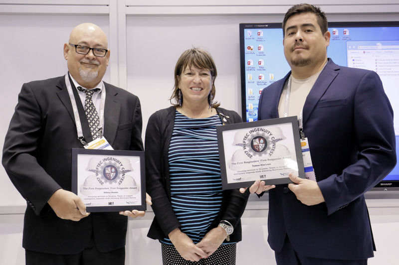 City of Houston operators Sidney Bomer (left) and Tomas Martinez (right) received he First Responders' First Responder Award from Joan Hawley, member of the WEF Board of Trustees, during WEFTEC 2017. Photo courtesy of Oscar & Associates.