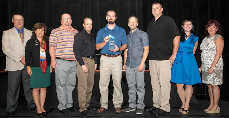 West (third from left) most fondly remembers when his team Elevated Ops won first place in Division 2 at WEFTEC 2016. Team members stand with event organizers with their first-place award. Photo courtesy of Kieffer Photography.