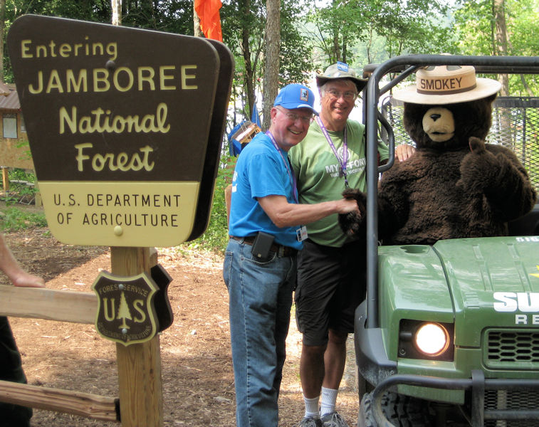From left, Spear and Condon pose with the Smokey the Bear mascot during the 2013 Boy Scout Jamboree. Photo courtesy of Spear.