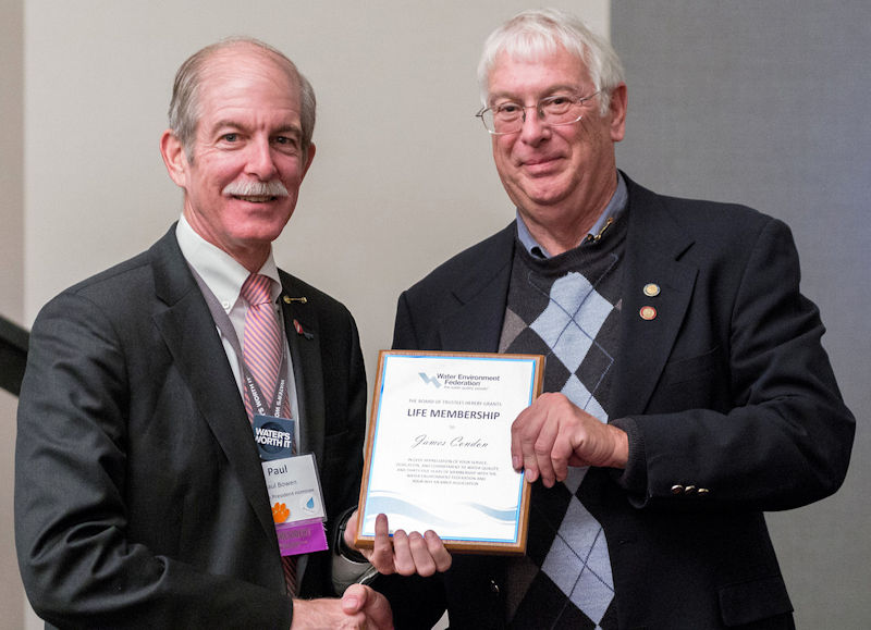 "James ""Jim"" Lee Condon (right) received his life member plaque from Paul Bowen, Water Environment Federation (WEF; Alexandria, Va.) past president. Condon joined WEF in 1976 and received life membership in 2013. Photo courtesy of Daryl Kottwitz."