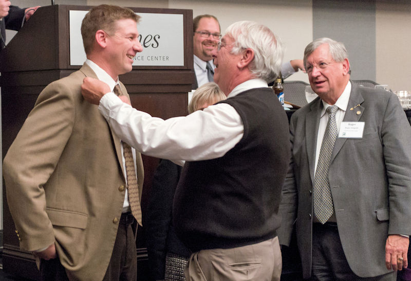 During the 2012 Nebraska WEA annual conference, Condon (front right) inducts Scott Aurit (left) into the organizations Select Society of Sanitary Sludge Shovelers. Photo courtesy of Kottwitz.