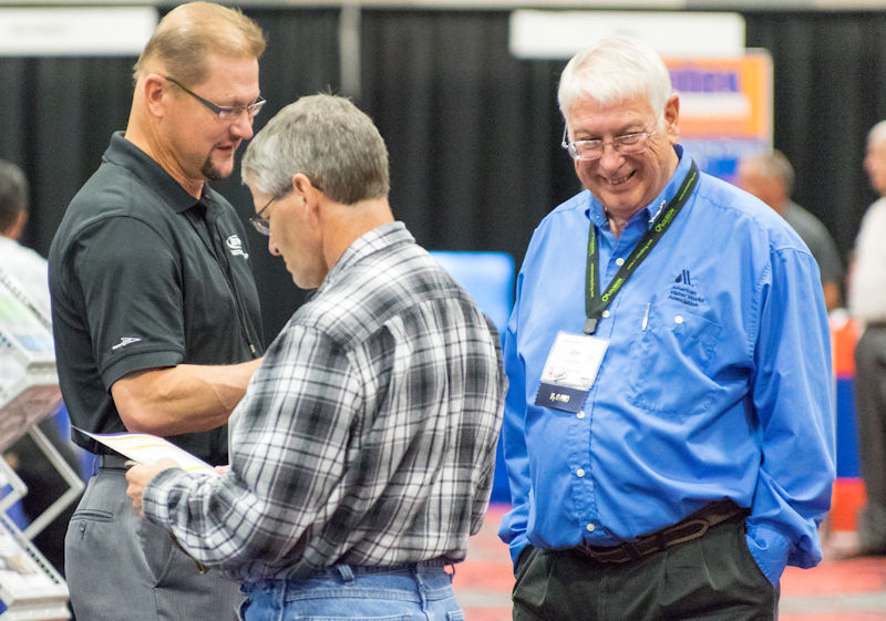 Condon (right) explores the exhibit floor at the 2015 Nebraska WEA annual conference. Photo courtesy of Kottwitz.