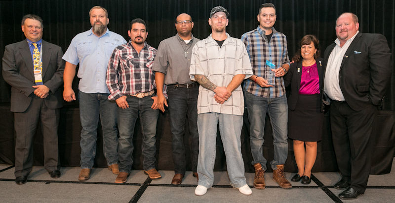 Mendez (third from right) holds the Aqua Techs' award for placing first overall in Division 2 at Operations Challenge 2017. Other team members include captain Kevin Willey, Ernesto Romero, coach Edward Burrell, and Ryan Brunette. Photo courtesy of Kieffer Photography.