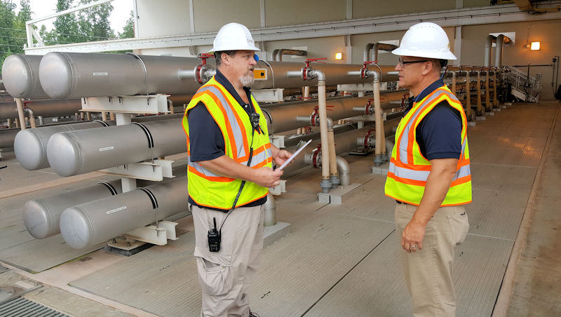 Bagwell trains Brand on the membrane process at Gwinnett County's Yellow River Water Reclamation Facility. Photo courtesy of Gwinnett County Department of Water Resources.