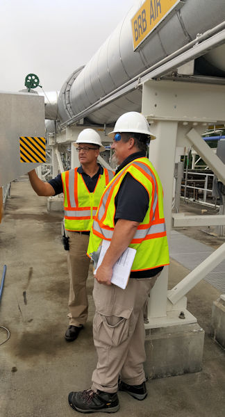 Gwinnett County (Ga.) Superintendent Ben Bagwell trains Operator Chip Brand on the biological reactors at Gwinnett County's Yellow River Water Reclamation Facility. Photo courtesy of Gwinnett County Department of Water Resources.
