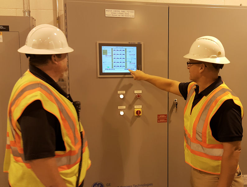 Bagwell continues Brand's training with the supervisory control and data acquisition (SCADA) system at Gwinnett County's Yellow River Water Reclamation Facility. Photo courtesy of Gwinnett County Department of Water Resources.