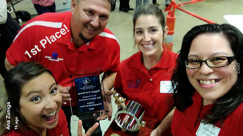 From left, members of the Big D Lady Tappers Jessica, coach Adam Hewitt, Jessica Staggs, and Ana-Alicia Zuñiga hold their first place award form the North Texas Annual Invitational Competition 2017. Photo courtesy of Ana-Alicia Zuñiga.
