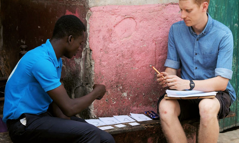 During a trip to Ghana, nano membrane toilet scientists surveyed potential users about their needs and discussed the design of their toilet. Tierney (right) takes a respondent through a hidden needs assessment. Photo courtesy of Jake Larsson, Cranfield University Water Science Institute.