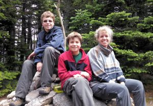 From right, Chesebrough sits with her son's Christopher Passariello and Anthony Passariello after a family hike in 2015. She has committed to educating her family about wastewater treatment processes, water conversation, and pollution prevention. Photo courtesy of Chesebrough.