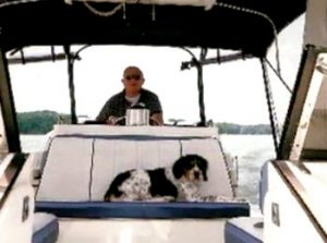 Roy Herwig takes his boat out on Lake Lanier in Georgia with his dog Prince. Photo courtesy of Liz Herwig.