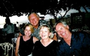 During a 2003 WEF CMOM conference in Honolulu, WEF members Roy Herwig (left) and George Martin (right), general manager of Greenwood Metropolitan District, go to dinner with their wives Liz Herwig (left) and Margaret Martin (center). Photo courtesy of Liz Herwig.