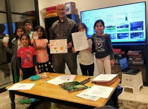 Bhattarai teaches elementary school students in Austin about wastewater treatment. Photo courtesy of Bhattarai.