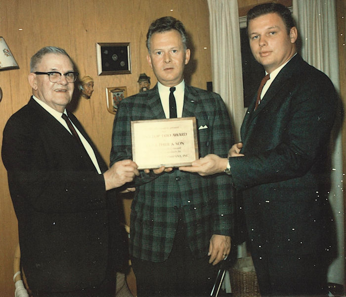 In 1968, J.T. Guthrie (left) and son, Tom Guthrie Sr. (right) stand with colleague Ward Clark. The trio hold an award presented to the water and wastewater treatment equipment business, J.T. Guthrie and Son. Photo courtesy of the Guthrie family.
