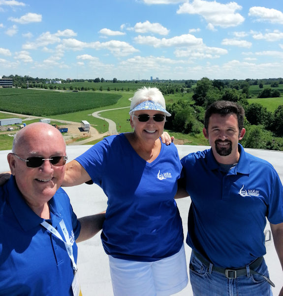 From left, Vernon and his wife, Beth, stand with their son Chase Azevedo on top of a Lexington-Fayette wet weather storage tank during the 2017 Kentucky-Tennessee Water Professionals Conference. The tank is one of ten designed and constructed under Vernon's direction. Photo courtesy of the Azevedo family.