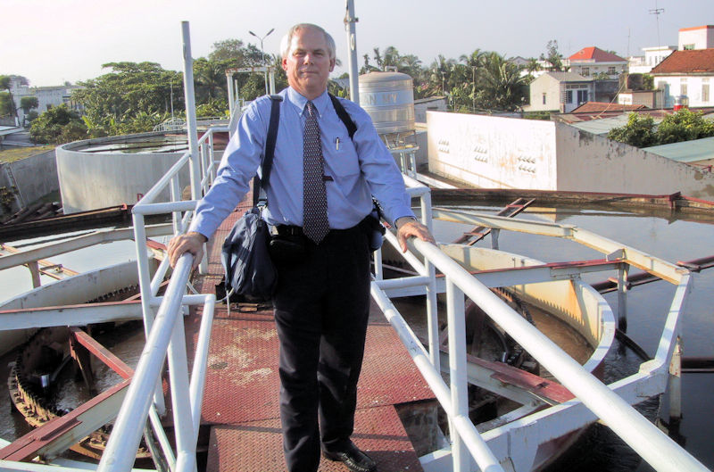 Al Goodman tours the wastewater treatment system at a water resource recovery facility in Hanoi, Vietnam. Photo courtesy of Goodman.