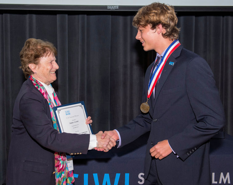From left, Jeanette Brown, past Water Environment Federation (Alexandria, Va.) and head judge of the 2018 U.S. SJWP competition, presents Milford with his award. Milford will represent the U.S. at the international SJWP competition in August. Photo courtesy of AOB Photo.